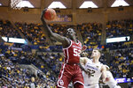 Oklahoma forward Kur Kuath (52) shoots the ball while defended by West Virginia guard Sean McNeil (22) during the first half of an NCAA college basketball game Saturday, Feb. 29, 2020, in Morgantown, W.Va. (AP Photo/Kathleen Batten)