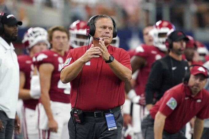 Arkansas head coach Sam Pittman calls for a time out in the first half of an NCAA college football game against Texas A&M in Arlington, Texas, Saturday, Sept. 25, 2021. (AP Photo/Tony Gutierrez)