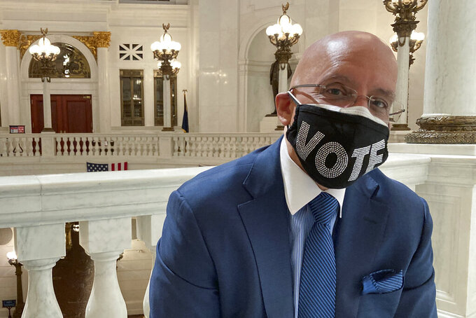Pennsylvania state Sen. Vince Hughes, D-Philadelphia, poses in the Rotunda of the state Capitol in Harrisburg, Pa on Wednesday May 21, 2021. State voters next week will decide whether to add a racial equality provision to the state constitution, a measure Hughes introduced last year, two weeks after George Floyd was killed by police in Minneapolis. (AP Photo/Mark Scolforo)