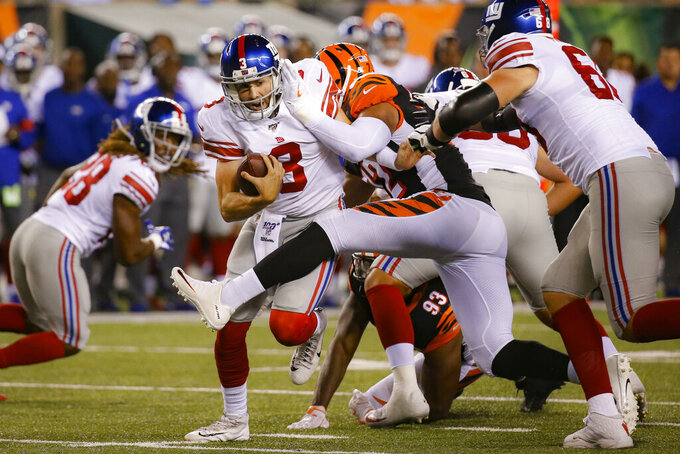 New York Giants quarterback Daniel Jones (8) is sacked by Cincinnati Bengals defensive end Kerry Wynn (72) during the second half of an NFL preseason football game Thursday, Aug. 22, 2019, in Cincinnati. (AP Photo/Frank Victores)