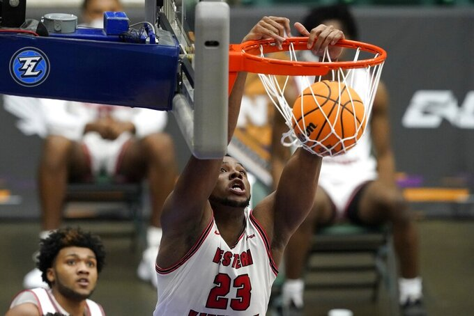 Western Kentucky center Charles Bassey dunks during the second half of the team's NCAA college basketball game against Louisiana Tech in the quarterfinals of the NIT, Thursday, March 25, 2021, in Frisco, Texas. (AP Photo/Tony Gutierrez)