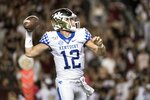 Kentucky quarterback Sawyer Smith (12) attempts a pass against South Carolina during the first half of an NCAA college football game Saturday, Sept. 28, 2019, in Columbia, S.C. (AP Photo/Sean Rayford)