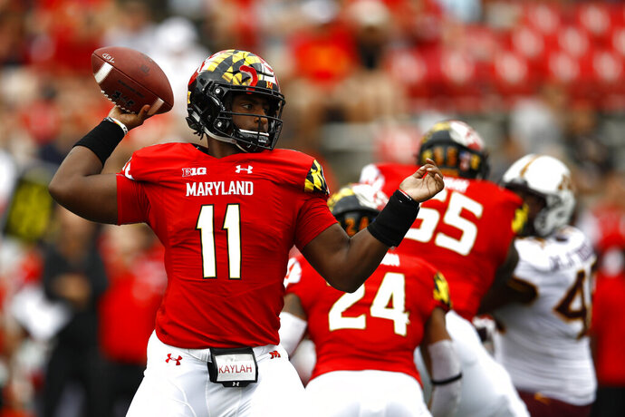 FILE - In this Sept. 22, 2018, file photo, then-Maryland quarterback Kasim Hill throws to a receiver in the first half of an NCAA college football game against Minnesota in College Park, Md. Former Maryland quarterback Kasim Hill has transferred to Tennessee. Tennessee athletic department spokesman Zach Stipe confirmed Thursday, Aug. 22, 2019, that the Volunteers have added Hill as a walk-on.  Hill won't play this season due to NCAA transfer rules.(AP Photo/Patrick Semansky, File)