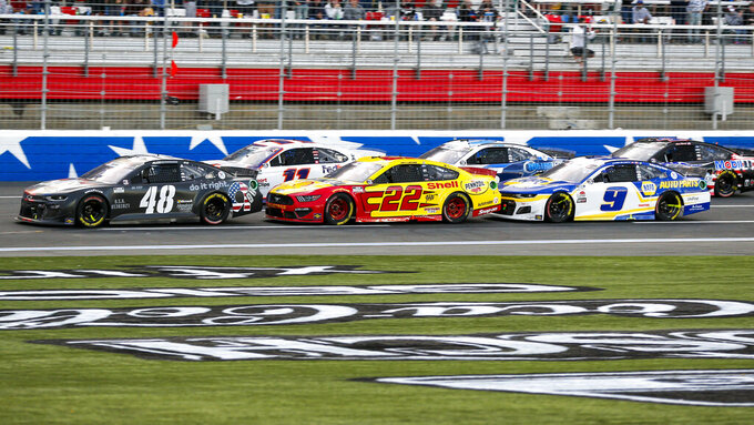 Alex Bowman (48), Joey Logano (22) and Chase Elliott (9) compete during a NASCAR Cup Series auto race at Charlotte Motor Speedway in Concord, N.C., Sunday, May 30, 2021. (AP Photo/Nell Redmond)