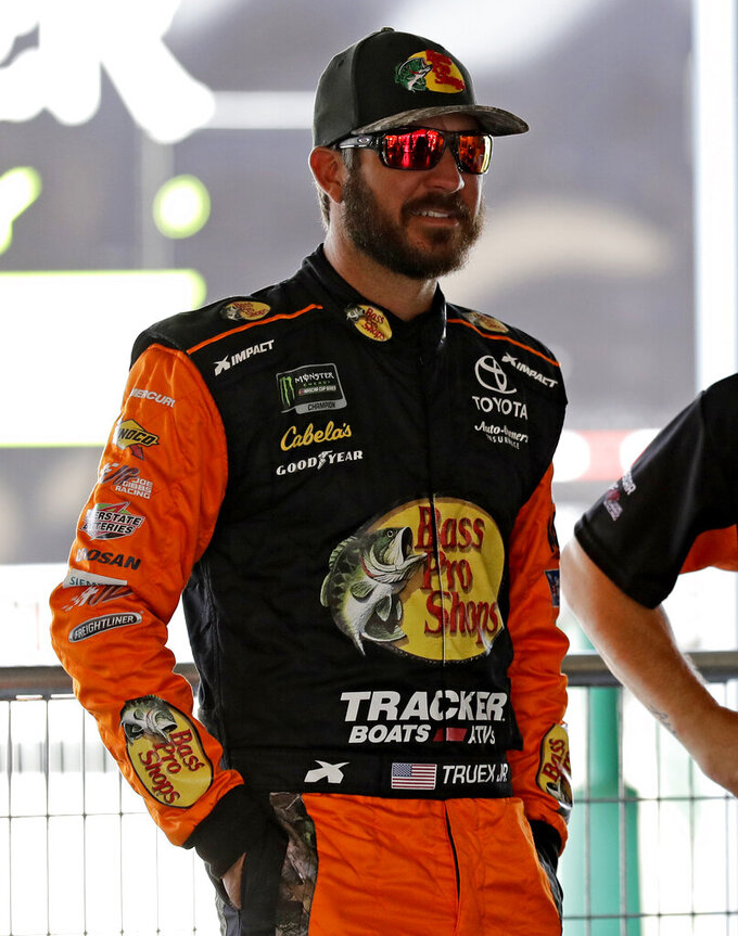 Martin Truex Jr., looks around his garage during a practice for the NASCAR Sprint Cup Series auto race at Chicagoland Speedway in Joliet, Ill., Saturday, June 29, 2018. (AP Photo/Nam Y. Huh)
