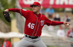 Washington Nationals starting pitcher Patrick Corbin (46) delivers in the first inning of an exhibition spring training baseball game against the St. Louis Cardinals on Friday, March 8, 2019, in Jupiter, Fla. (AP Photo/Brynn Anderson)