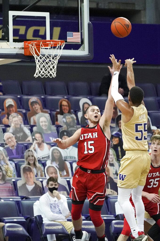 Washington guard Quade Green (55) shoots over Utah guard Rylan Jones (15) during the second half of an NCAA college basketball game, Sunday, Jan. 24, 2021, in Seattle. Washington won 83-79. (AP Photo/Ted S. Warren)