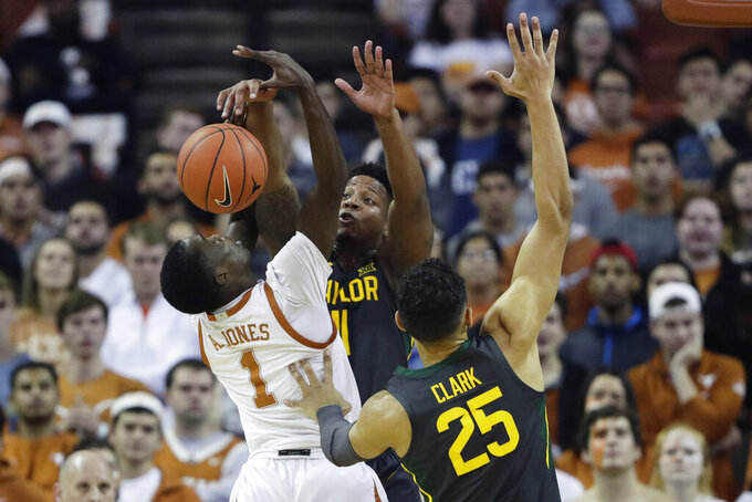 Texas guard Andrew Jones (1) is blocked by Baylor guard Mark Vital (11) during the first half of an NCAA college basketball game, Monday, Feb. 10, 2020, in Austin, Texas. (AP Photo/Eric Gay)