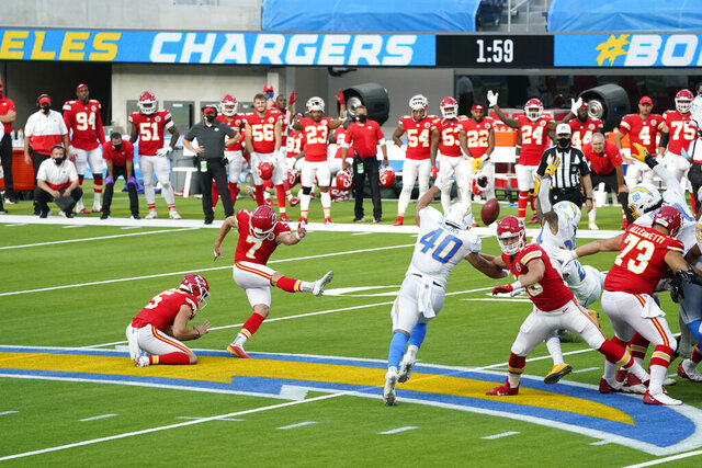 Kansas City Chiefs kicker Harrison Butker (7) hits the game-winning field goal during overtime of an NFL football game against the Los Angeles Chargers Sunday, Sept. 20, 2020, in Inglewood, Calif. Kansas City won 23-20. (AP Photo/Ashley Landis )