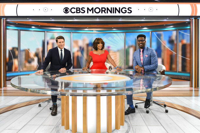 """This image released by CBS News shows """"CBS Mornings"""" hosts, from left, Tony Dokoupil, Gayle King, and Nate Burleson on the set in New York on Aug. 30, 2021. Burleson will join the show on Sept. 7. (Michele Crowe/CBS via AP)"""