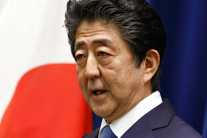 Japan's Prime Minister Shinzo Abe speaks during a press conference at the prime minister's official residence, Thursday, June 18, 2020, in Tokyo. Abe said Thursday that he regretted the arrest of his former justice minister and the minister's lawmaker wife over allegations they engaged in vote buying during last year's election, and that he takes the public criticism seriously. (Rodrigo Reyes Marin/Pool Photo via AP)