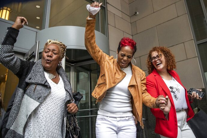 Ketra Veasy, center, sister of Willie Veasy, who has been imprisoned for 27 years for a murder he insists he did not commit, celebrates along with Celeste Trusty of FAMM, right, and Debra Chappell as they exit the Center for Criminal Justice following Veasy's exoneration on Wednesday, Oct. 9, 2019 in Philadelphia. Willie Veasy who has maintained his innocence in a murder case for nearly three decades has been ordered freed from prison after a judge overturned his conviction. (Heather Khalifa/The Philadelphia Inquirer via AP)