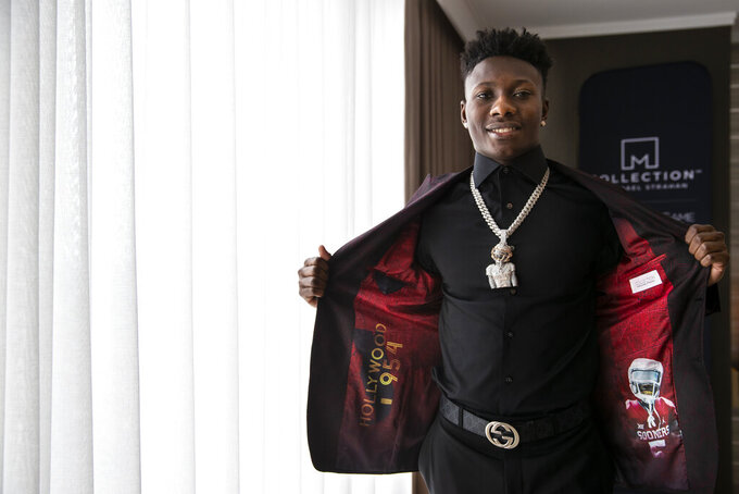 "IMAGE DISTRIBUTED FOR JCPENNEY - Top NFL Draft prospect, Marquise ""Hollywood"" Brown, partnered with COLLECTION by Michael Strahan exclusively available at JCPenney to show off his style as he heads to the draft on Thursday, April 25, 2019 in Nashville, Tenn. Brown personalized his jacket liner to represent his nickname and hometown, ""Hollywood,"" and his alma mater, The University of Oklahoma. (Brett Carlsen/AP Images for JCPenney)"
