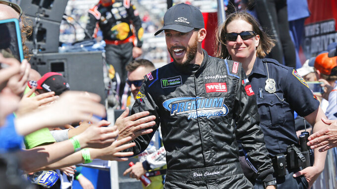NASCAR Cup Series driver Ross Chastain (15) greets fans during driver introductions prior to the NASCAR Cup Series auto race at the Martinsville Speedway in Martinsville, Va., Sunday, March 24, 2019. (AP Photo/Steve Helber)