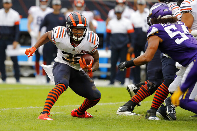 Chicago Bears running back David Montgomery, left, runs with the ball as Minnesota Vikings middle linebacker Eric Kendricks (54) defends during the half of an NFL football game Sunday, Sept. 29, 2019, in Chicago. (AP Photo/Jeff Roberson)