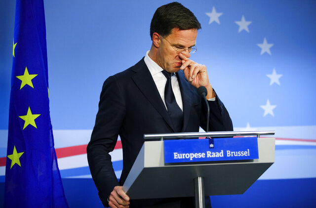 Dutch Prime Minister Mark Rutte speaks during a media conference at the end of an EU summit in Brussels, Friday, Feb. 21, 2020. Major contributors to the European Union's budget blocked progress at an emergency summit on Friday, insisting that they would not stump up more funds for the bloc's next long-term spending package. (AP Photo/Olivier Matthys)