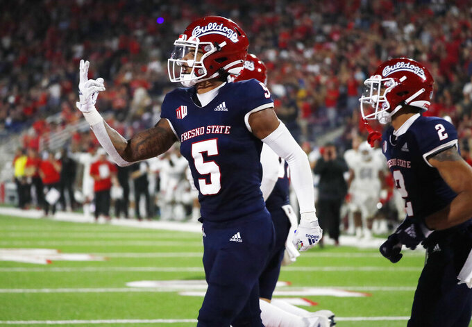 Fresno State wide receiver Jalen Cropper celebrates after a touchdown against UNLV during the second half of an NCAA college football game in Fresno, Calif., Friday, Sept. 24, 2021. (AP Photo/Gary Kazanjian)