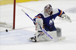 New York Islanders goaltender Semyon Varlamov (40) watches as the puck shot by Washington Capitals' Jakub Vrana (13) gets past him for a goal during the third period of an NHL hockey game Saturday, Jan. 18, 2020, in Uniondale, N.Y. The Capitals won 6-4. (AP Photo/Frank Franklin II)