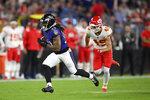 Baltimore Ravens running back Devonta Freeman, left, rushes past Kansas City Chiefs defensive back Daniel Sorensen in the first half of an NFL football game, Sunday, Sept. 19, 2021, in Baltimore. (AP Photo/Nick Wass)