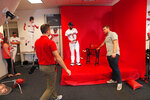 Boston Red Sox second baseman Dustin Pedroia takes direction for a Red Sox promotional photo shoot, during media day at their spring training baseball facility in Ft. Myers, Fla., Tuesday, Feb. 19, 2019. (AP Photo/Gerald Herbert)