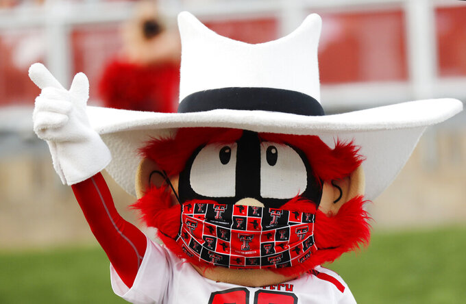 "Texas Tech mascot ""Raider Red"" wears a mask during an NCAA college football game against Houston Baptist, Saturday, Sept. 12, 2020, in Lubbock, Texas. (AP Photo/Mark Rogers)"