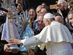 Pope Francis blesses two statues of Our Lady of Lujan, the original at left, and its replica as he meets with bishops from Britain and Argentina at the end of his weekly general audience in St. Peter's Square, at the Vatican, Wednesday, Oct. 30, 2019. The original statue of the Virgin Mary, Patroness of Argentina, which was brought to Britain at the end of the Falklands War, will be returned to Argentina and its replica, made in Argentina, will be donated to the Catholic Military Cathedral of St. Michael and St. George in Aldershot, Britain. (AP Photo/Andrew Medichini)