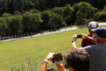 Spectators take snapshots of the pack during the stage 13 of the Tour de France cycling race over 191 kilometers from Chatel-Guyon to Puy Mary, Friday, Sept. 11, 2020. (AP Photo/Christophe Ena)