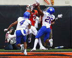 Oklahoma State wide receiver Tylan Wallace (2) cannot hold onto the pass between Boise State safety DeAndre Pierce (4) and cornerback Avery Williams (26) in the first half of an NCAA college football game in Stillwater, Okla., Saturday, Sept. 15, 2018. (AP Photo/Sue Ogrocki)