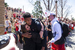 Texas Tech's Jarrett Culver (23) is welcomed by the crowd as he steps off the bus during a return party on Tuesday, April 9, 2019, in Lubbock, Texas. (Justin Rex/Lubbock Avalanche-Journal via AP)