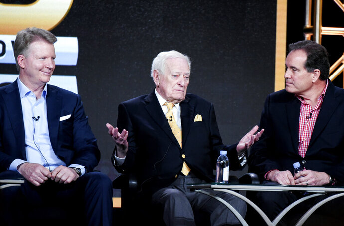 FILE - In this Jan. 12, 2016, file photo, from left to right, sportscasters Phil Simms, Jack Whitaker and Jim Nantz participate in the
