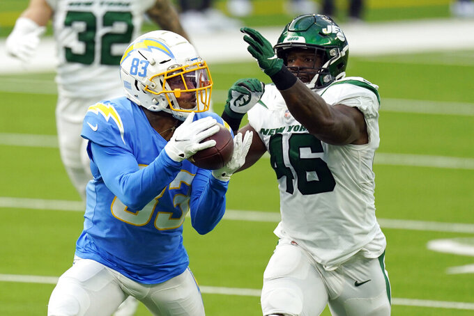Los Angeles Chargers wide receiver Tyron Johnson makes a catch in front of New York Jets linebacker Neville Hewitt during the first half of an NFL football game Sunday, Nov. 22, 2020, in Inglewood, Calif. (AP Photo/Jae C. Hong)