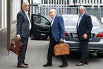 Former FIFA President Sepp Blatter, center, appears in front of the building of the Office of the Attorney General of Switzerland, on Tuesday, Sept.1, 2020, in Bern, Switzerland. Sepp Blatter and former UEFA president Michel Platini each face interrogation from the Swiss public prosecutor as part of the proceedings opened in 2015 over a payment of 2 million Swiss francs. (Peter Schneider/Keystone via AP)