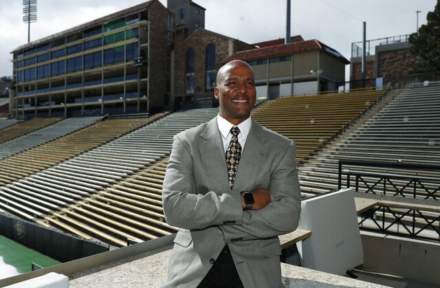 FILE - In this Feb. 24, 2020, file photo, Karl Dorrell poses for a photograph overlooking Folsom Field after a news conference to announce that he is the new NCAA college head football coach at Colorado during a news conference in Boulder, Colo. Colorado will host UCLA on Nov. 7, 2020, to begin the Dorrell Era in Boulder, where he steps in for Mel Tucker after Tucker unexpectedly bolted for Michigan State in February. (AP Photo/David Zalubowski, File)