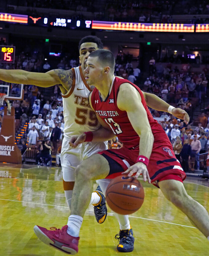 Texas Tech guard Matt Mooney (13) drives to the basket against Texas guard Elijah Mitrou-Long (55) during the first half of an NCAA college basketball game, Saturday, Jan. 12, 2019, in Austin, Texas. (AP Photo/Michael Thomas)