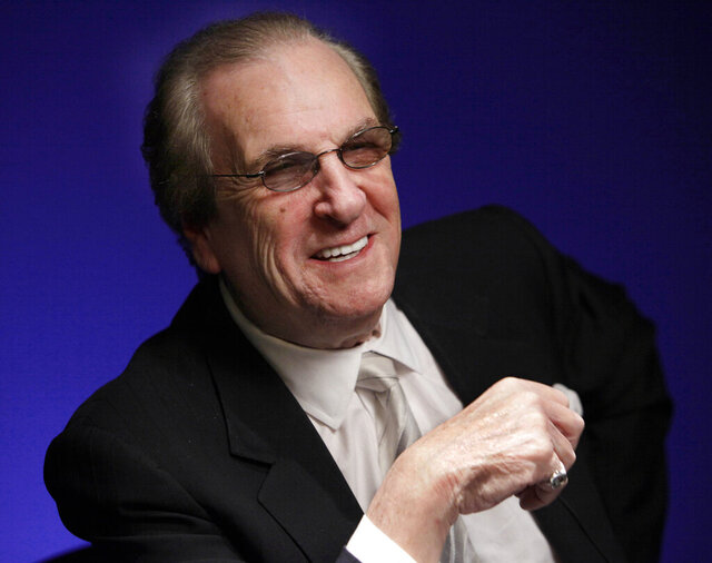 "FILE - In this Friday, Oct. 7, 2011, file photo, actor Danny Aiello smiles while being photographed in New York. Super Bowl MVP Eli Manning, legendary Rutgers women's basketball coach C. Vivian Stringer, ""Roots"" and ""Good Times"" star John Amos, and actors Flip Wilson and Aiello will be among those inducted into the New Jersey Hall of Fame on Sunday, Oct. 18, 2020. (AP Photo/Richard Drew, File)"