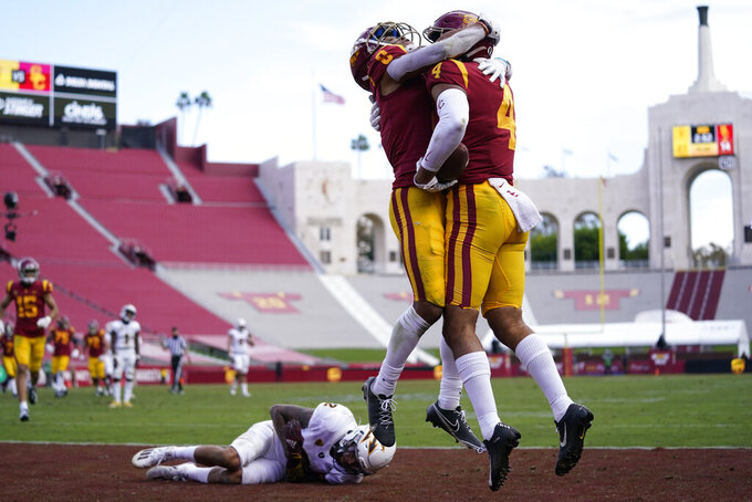 Southern California wide receiver Bru McCoy (4) celebrates with Amon-Ra St. Brown (8) after catching a pass in the end zone for a touchdown against Arizona State during the second half of an NCAA college football game Saturday, Nov. 7, 2020, in Los Angeles. (AP Photo/Ashley Landis)