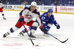 Columbus Blue Jackets' Max Domi (16) fends off the defense of Tampa Bay Lightning's Ryan McDonagh (27)   during the first period of an NHL hockey game Sunday, April 25, 2021, in Tampa, Fla. (AP Photo/Mike Carlson)
