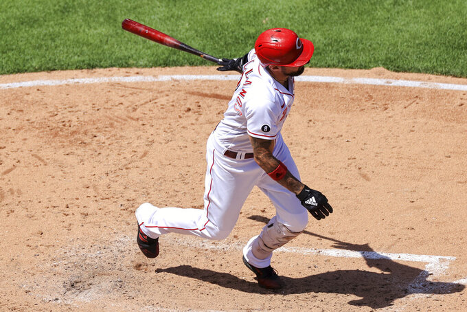 Cincinnati Reds' Nick Castellanos hits a single during the fifth inning of a baseball game against the Philadelphia Phillies in Cincinnati, Monday, May 31, 2021. (AP Photo/Aaron Doster)