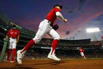 Boston Red Sox's Enrique Hernandez takes the field at the top of the fifth inning during a baseball game against the Houston Astros, Wednesday, June 9, 2021, in Boston. (AP Photo/Michael Dwyer)