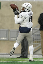 Utah State wide receiver Aaren Vaughns catches a pass for a touchdown against Colorado State during the second half of an NCAA football game Saturday, Nov. 17, 2018, in Fort Collins, Colo. (AP Photo/Jack Dempsey)
