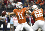 Texas quarterback Sam Ehlinger (11) throws a pass against Oklahoma during the first half of the Big 12 Conference championship NCAA college football game on Saturday, Dec. 1, 2018, in Arlington, Texas. (AP Photo/Jeffrey McWhorter)