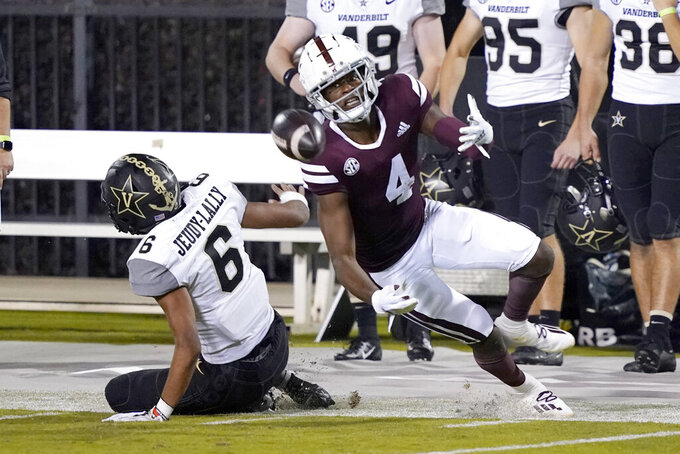 Mississippi State wide receiver Malik Heath (4) tries unsuccessfully to catch a pass after clashing with Vanderbilt cornerback Gabe Jeudy-Lally (6) during the second half of an NCAA college football game in Starkville, Miss., Saturday, Nov. 7, 2020. (AP Photo/Rogelio V. Solis)