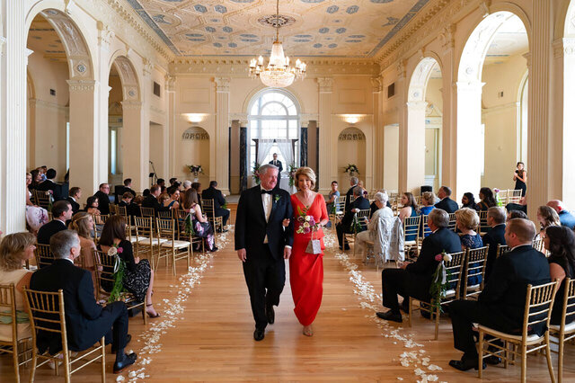 In this photo provided by Ember Studio, White House Chief of Staff Mark Meadows and his wife, Debbie Meadows, walk down the aisle at their daughter's wedding, Sunday, May 31, 2020, in Atlanta. (Courtesy of Ember Studio via AP)