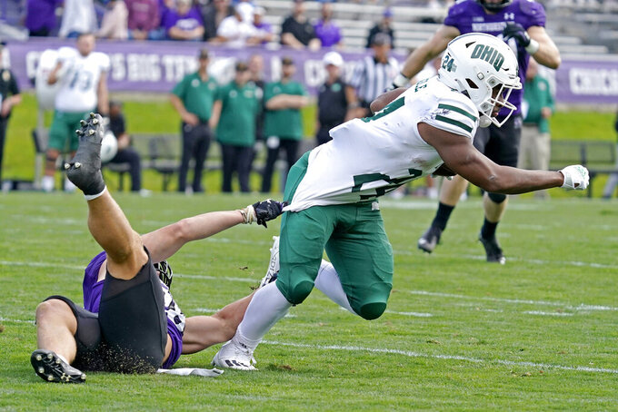 Ohio running back De'Montre Tuggle, right, is tackled by Northwestern linebacker Chris Bergin during the second half of an NCAA college football game in Evanston, Ill., Saturday, Sept. 25, 2021. Northwestern won 35-6. (AP Photo/Nam Y. Huh)