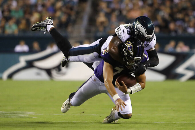 Philadelphia Eagles' Rodney McLeod, top, tackles Baltimore Ravens' Trace McSorley during the first half of a preseason NFL football game Thursday, Aug. 22, 2019, in Philadelphia. (AP Photo/Matt Rourke)