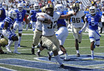 Army running back Tyson Riley (32) celebrates after scoring a touchdown against Georgia State during the first quarter of an NCAA football game Saturday, Sept. 4, 2021, in Atlanta. (AP Photo/Ben Margot)