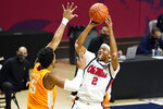 Mississippi guard Devontae Shuler (2) attempts a shot past Tennessee guard Josiah-Jordan James (5) during the first half of an NCAA college basketball game in Oxford, Miss., Tuesday, Feb. 2, 2021. (AP Photo/Rogelio V. Solis)