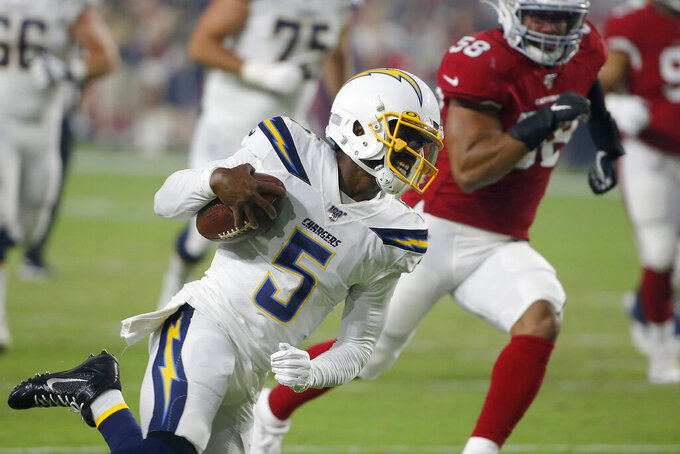 Los Angeles Chargers quarterback Tyrod Taylor (5) scrambles as Arizona Cardinals middle linebacker Jordan Hicks (58) pursues during the first half of an NFL preseason football game, Thursday, Aug. 8, 2019, in Glendale, Ariz. (AP Photo/Rick Scuteri)