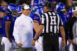 Kansas head coach Les Miles, left, talks with head linesman Al Green during the first half of an NCAA college football game against Texas Tech in Lawrence, Kan., Saturday, Oct. 26, 2019. (AP Photo/Orlin Wagner)
