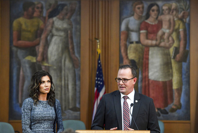South Dakota Governor Kristi Noem, left, and  Public Safety Secretary Craig Price, right, speak during an update on the investigation of the Saturday, Sept. 12 crash involving Attorney General Jason Ravnsborg, Tuesday, Oct. 13, 2020, in Sioux Falls, SD.  (Erin Bormett/The Argus Leader via AP)